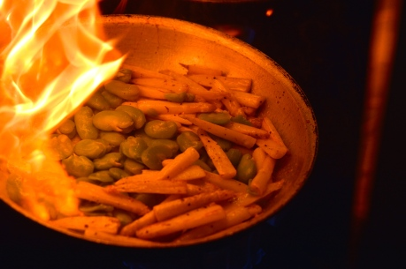 Fava beans and white asparagus tossed over heat